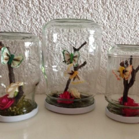 Schmetterlinge und Natur im Glas Hand im Glück