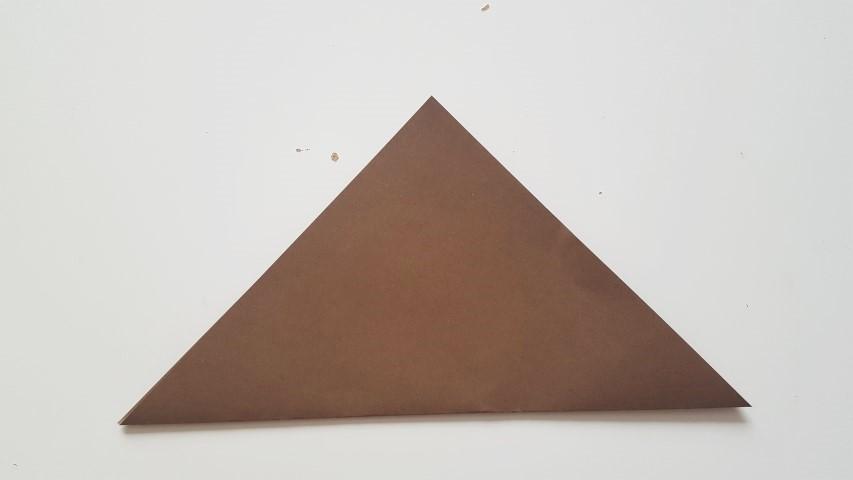 Origami Fuchs Schritt 2 Origamiblatt falten Hand im Glück