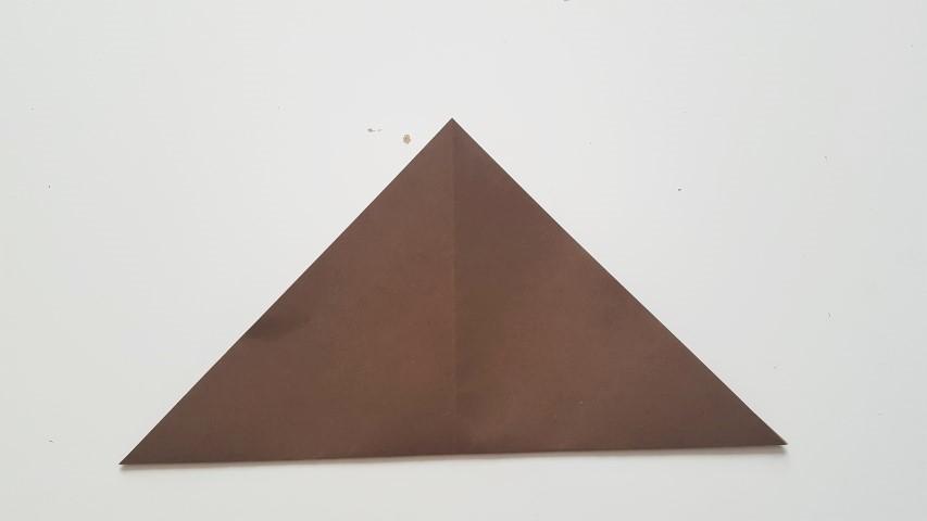 Origami Fuchs Schritt 4 Blatt zusammen gefalten lassen Hand im Glück (2)