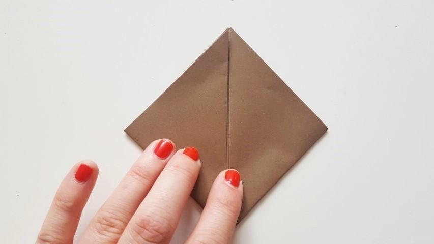 Origami Fuchs Schritt 6 Origamiblatt Hand im Glück