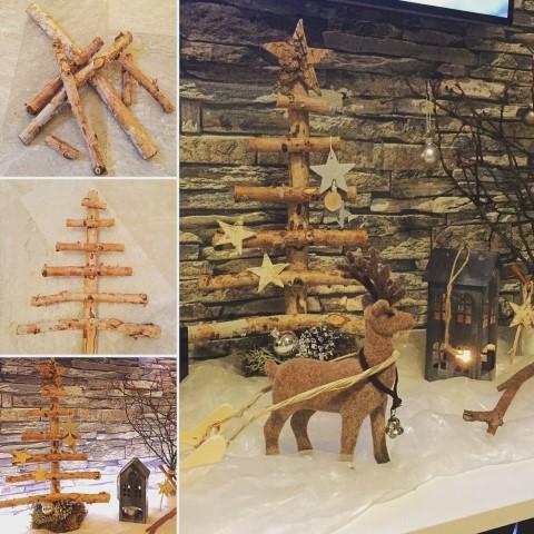 Dekoration Weihnachten Tannenbaum aus Holz Hand im Glück
