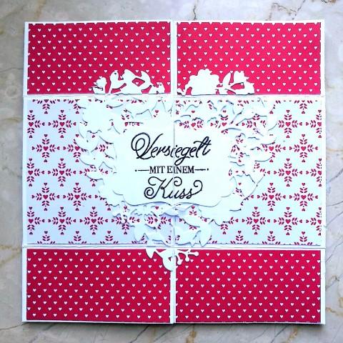 Endloskarte aus einem Blatt Karton aus Papier Hand im Glück