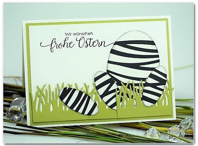 Zebra Ei als Karte zu Ostern aus Papier Hand im Glück