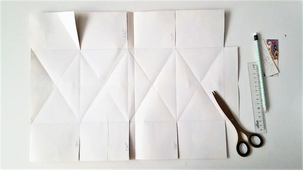 Hand im Glück Tassenverpackung aus Papier Diagonale falten